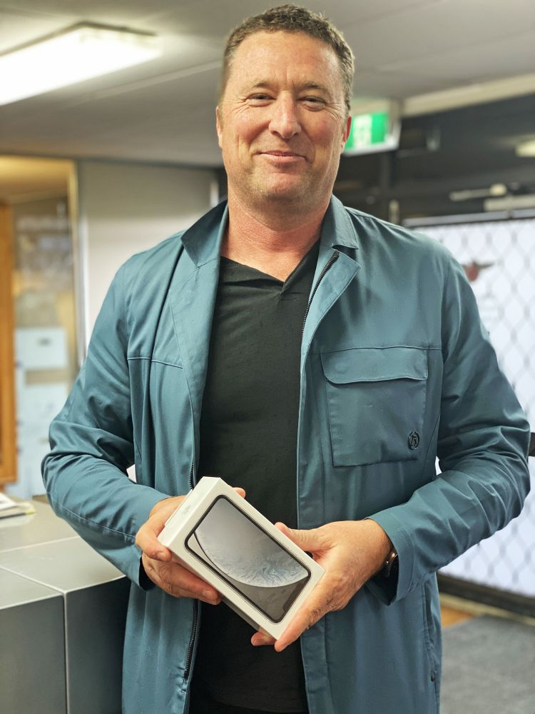 Greg Southcombe at the National Office with his brand new iPhone XR